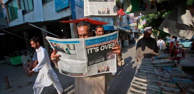 Pakistani man reading a newspaper