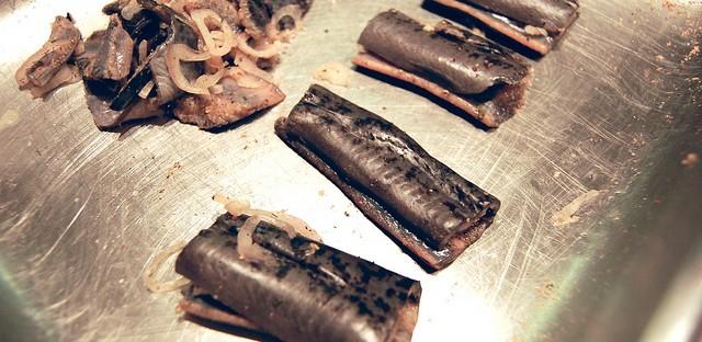 Seasoned lamprey with shallots at Pleasant House Bakery