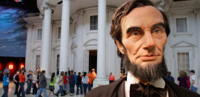 "In this Feb. 10, 2012 file photo, school students enter the ""White House"" as a life-size Abraham Lincoln replica stands outside, while touring the Abraham Lincoln Presidential Library and Museum in Springfield, Ill."