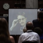 National Security Agency leaker Edward Snowden speaks via video link during the Athens Democracy Forum, organized by The New York Times, at the National Library in Athens on Sept. 16, 2016. Snowden is in exile in Moscow; Russia has extended his residence permit.