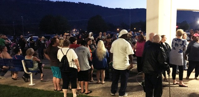 About 100 people slept in their cars overnight in the Red Bank High School parking lot waiting to receive medical care in Chattanooga, Tenn.