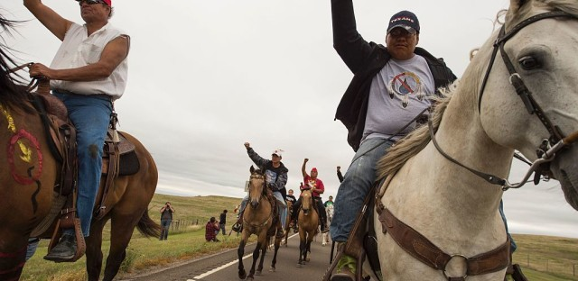 """Protesters ride near the site of construction. The company building the pipeline says in court documents that it """"is not destroying and has not destroyed any evidence or important historical sites."""""""