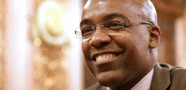 Illinois Sen. Kwame Raoul, D-Chicago, smiles as his concealed carry gun legislation passes during a Senate Executive Committee hearing at the Illinois State Capitol Tuesday, May 28, 2013