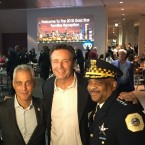 "Former Officer Brian Warner (center) stands next to Chicago Mayor Rahm Emanuel and Police Superintendent Eddie Johnson. Warner plans to fight a Chicago police pension board decision to reduce his pension payments and take away his health care coverage after determining his PTSD is ""in remission."""