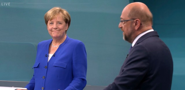 German Chancellor Angela Merkel, left, of the Christian Democratic party, and her challenger Martin Schulz of the Social Democratic party attend the only TV debate three weeks before the German parliament elections in a TV studio in Berlin Sunday, Sept. 3, 2017.