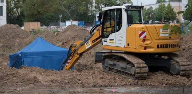 A blue tent covers a British World War II bomb that was found during construction. Disposal operations are set for Sunday and require what's expected to be Germany's biggest evacuation since the war.
