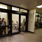 In this Sept. 29, 2011 photo, inmates at the Cook County Jail in Chicago, the second largest county jail in the nation, wait to be processed for release.