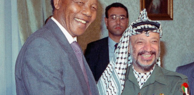 South African anti-apartheid leader Nelson Mandela meets with Palestinian Liberation Organization Chairman Yasser Arafat, right, on Sunday, May 20, 1990 in Cairo. Both Palestinians and Israelis saw Mandela as a champion of their nationalist struggles.