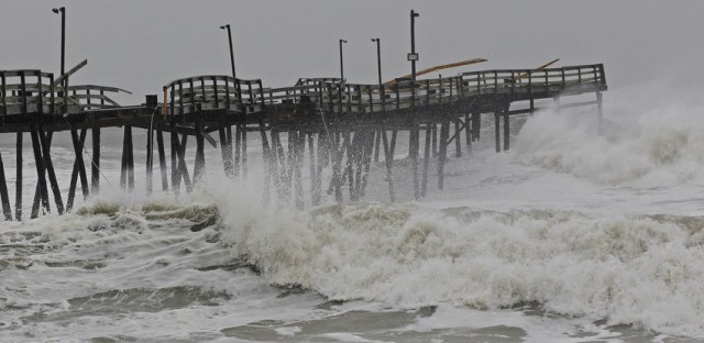 Waves from Hurricane Sandy crash onto the damaged Avalon Pier in Kill Devil Hills, N.C., Monday.