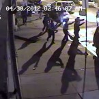 In this April 30, 2012, video frame grab provided by the Independent Police Review Authority, Chicago police fire shots at a vehicle. Police alleged three men were robbing an electronics store by putting items into a stolen vehicle parked inside the store. Police said at the time that officers surrounded the building to get the men to surrender, but once the suspects tried to drive off and the vehicle hit an officer, police fired shots. It is one of the more than 300 video clips released Friday, June 3, 2016, by the IPRA that investigates police misconduct cases.