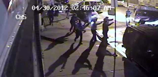 In this April 30, 2012, video frame grab provided by the Independent Police Review Authority, Chicago police fire shots at a vehicle.
