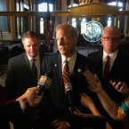 Illinois Gov. Bruce Rauner, center, addresses reporters outside his state Capitol office in Springfield on May, 8, 2018.