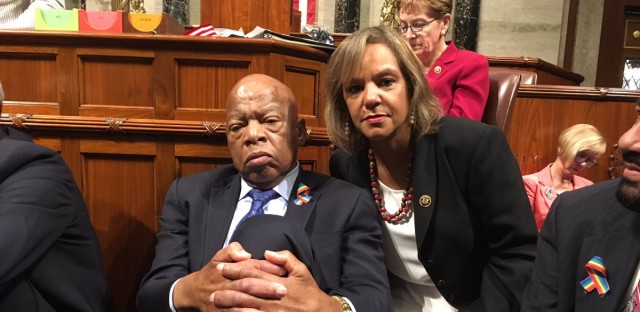 "Rep. Kelly shares a photo with Rep. Lewis during the sit-in staged my House Democrats on June 22, 2016. She Tweeted, ""6 hours+ into the gun violence sit-in w/ @repjohnlewis. We will #holdthefloor until we get a vote #NoBillNoBreak"""