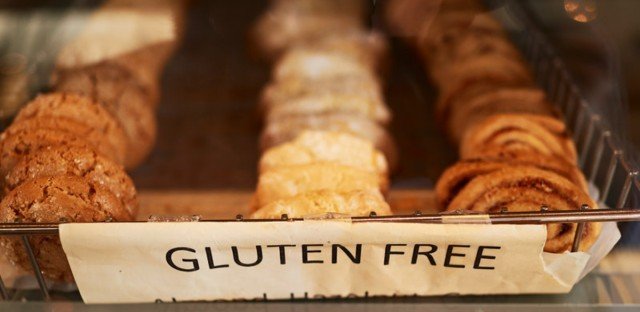 A tray of gluten-free pastries. For people with celiac disease, incidental ingestion of gluten can lead to to painful symptoms and lasting intestinal damage. Two new studies suggest such exposure may be greater than many realize, even for those following gluten-free diets. (JPM/Getty Images/Image Source)
