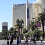 People cross the Las Vegas Strip where a lone gunman opened fire on the audience at the Route 91 Harvest country music festival on Oct. 1. The gunman, identified as Stephen Paddock, 64, of Mesquite, Nev., fired from a room on the 32nd floor of the Mandalay Bay Resort and Casino. David Becker/Getty Images