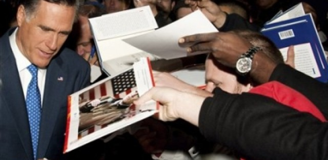 "Republican presidential candidate Mitt Romney signs autographs after appearing on ""Late Show with David Letterman""."