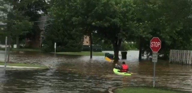 A resident of Gurnee, Illinois takes out a kayak near his home.