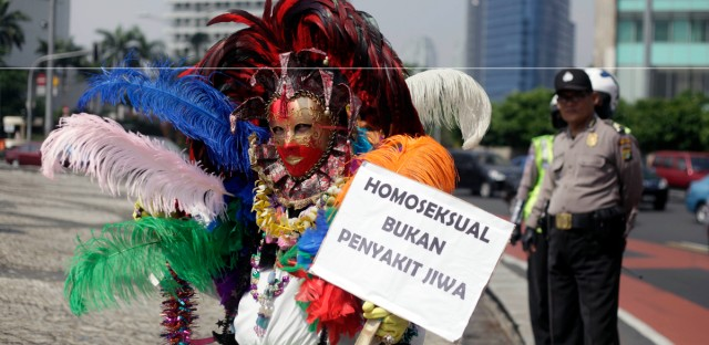 A masked gay activist at a protest demanding equality for LGBT people in Jakarta, Indonesia in 2011. Homosexuals and transgenders in the world's most populous Muslim country still face discrimination today.