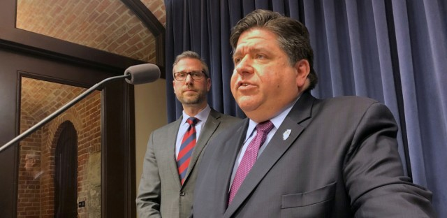 Illinois Gov. JB Pritzker speaks at a state Capitol news conference on Jan. 23, 2019, in Springfield, Ill., as state Treasurer Michael Frerichs looks on.
