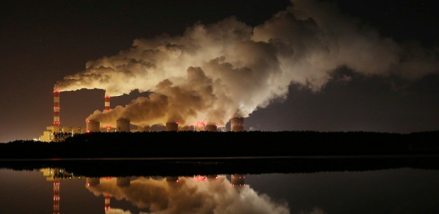 In this Wednesday, Nov. 28, 2018 file photo, plumes of smoke rise from Europe's largest lignite power plant in Belchatow, central Poland. After several years of little growth, global emissions of heat-trapping carbon dioxide surged in 2018 with the largest jump in seven years, discouraged scientists announced Wednesday, Dec. 5, 2018.