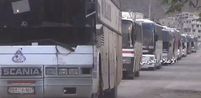 Buses carry Syrians as they leave on Friday from Madaya, an opposition-held town near Damascus, Syria.