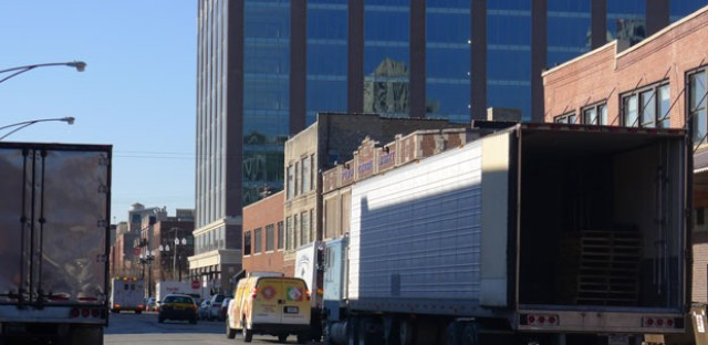 Meatpacking trucks in the shadows of the new Google Chicago headquarters on West Fulton Market.