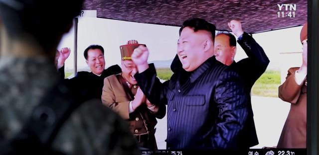 A South Korean soldier watches a TV local news program Saturday depicting North Korean leader Kim Jong Un.