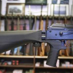 A bump stock (left) fits on a semi-automatic rifle to increase the firing speed, making it similar to a fully automatic rifle. Some lawmakers are calling for restrictions on the device after the Las Vegas shooting.