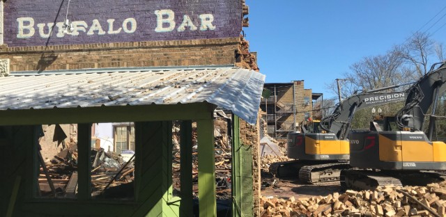 Construction workers started the demolition the Heartland Cafe in Rogers Park on Tuesday. The neighborhood fixture brought hearty food, lively music and activists of progressive bent to the corner of Glenwood and Lunt avenues for more than four decades.