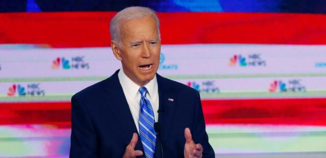 Democratic presidential candidate former Vice President Joe Biden, left, and Sen. Kamala Harris, D-Calif., spar during the Democratic primary debate on Thursday, June 27, 2019, in Miami.