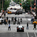 Commuters return to work in downtown Chicago, Monday, May 21 2012, on the final day of the NATO summit. The numbers of passengers taking trains and buses in Chicago appear to be way down Monday, as many commuters seemed to heed advice to stay home while the NATO summit enters its final day. (AP Photo/Charles Rex Arbogast)