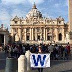 Cubs fan Brittany Drehobl flies the W at St. Peter's Square in Vatican City.