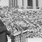 Dr. Martin Luther King addresses a crowd estimated at 70,000 at a civil rights rally in Chicago's Soldier Field in 1964.