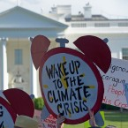 In this June 1, 2017 file photo, protesters gather outside the White House in Washington to protest President Donald Trump's decision to withdraw the Unites States from the Paris climate change accord.
