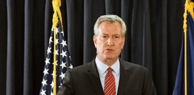 New York City Mayor Bill de Blasio speaks with reporters about preparations for an upcoming snow storm and remarks on New York Gov. Andrew Cuomo's state of the state address on Wednesday, Jan. 3, 2018, in Albany, N.Y.