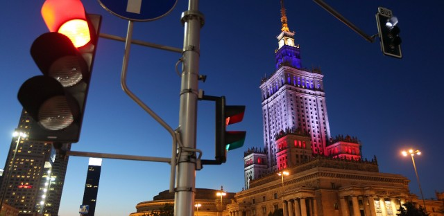 The French national colors are projected onto the Palace of Culture and Science in Warsaw, Poland, Friday, July 15, 2016. A truck slammed into revelers on Bastille day, the French national holiday, on Thursday in the French resort city of Nice, killing at least 80 people and leaving hundreds injured.