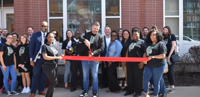 Jeremy Foster, CEO of Big Brothers Big Sisters of Metropolitan Chicago, cuts the ribbon at the organization's new Englewood location