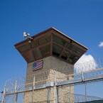 In this photo reviewed by U.S. military officials, a U.S. flag is displayed on the control tower of the Camp VI detention facility, Wednesday, April 17, 2019, in Guantanamo Bay Naval Base, Cuba.