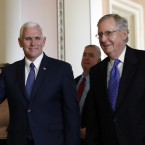 Vice President-elect Mike Pence waves as he leaves a meeting with Senate Majority Leader Mitch McConnell.