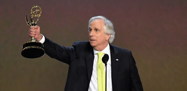 Henry Winkler accepts the award for outstanding supporting actor in a comedy series for 'Barry' during the 70th Emmy Awards.