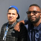 Joel Contreras, left, an Operation Peacemaker Fellow, and Joseph McCoy, a Neighborhood Change Agent with the Office of Neighborhood Safety, in Richmond, Cali. Fellows receive counseling, social services, a job and cash if they agree to stay in contact everyday and stay out of trouble.