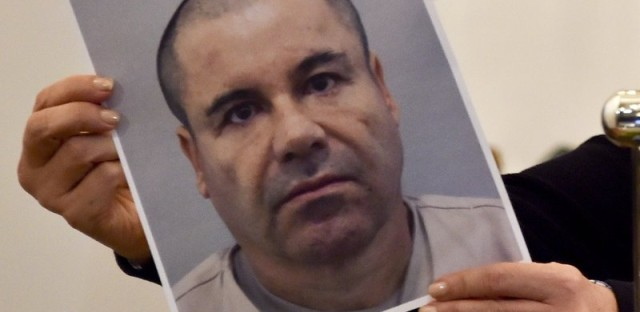 """Mexican drug kingpin Joaquin """"El Chapo"""" Guzman, seen here in a photo held by Mexico's Attorney General Arely Gomez last July, has been recaptured, Mexico's president says."""