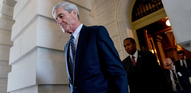 Former FBI Director Robert Mueller, the special counsel probing Russian interference in the 2016 election, departs Capitol Hill in this June 21, 2017, photo. On Friday, the Department of Justice announced that a grand jury has charged 13 Russian nationals and several Russian entities with violating U.S. criminal laws to interfere with American elections and the political process. (AP Photo/Andrew Harnik)