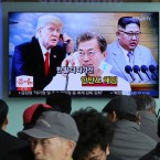 People watch a TV screen showing images of North Korean leader Kim Jong Un, right, South Korean President Moon Jae-in, center, and U.S. President Donald Trump at the Seoul Railway Station in Seoul, South Korea, Wednesday, March 7, 2018.