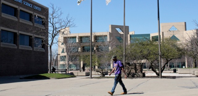 A student walks across Chicago State University's campus on April 12, 2016.