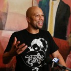 Common talks with media after performing at St. Sabina Church on Chicago's South Side in 2016. A performing arts school backed by Common is set to open this fall.