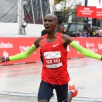 Mo Farah, of Britain, raises his arms after finishing in first place during the Bank of America Chicago Marathon, Sunday, Oct. 7, 2018, in Chicago.