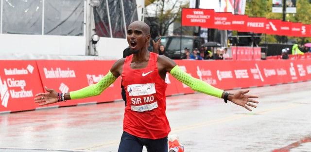 Mo Farah, of Britain, raises his arms after finishing in first place during the Bank of America Chicago Marathon on Sunday.