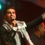 "Mohammed Assaf, the 23-year-old from the Gaza Strip who won the popular pan-Arab song contest ""Arab Idol"" last month performs in the West Bank city of Ramallah, Monday, July 1, 2013."