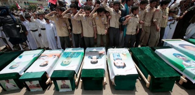 Yemeni people attend the funeral of victims of a Saudi-led airstrike, in Saada, Yemen, Monday, Aug. 13, 2018. Yemen's shiite rebels are backing a United Nations' call for an investigation into the airstrike in the country's north that killed dozens of people including many children.